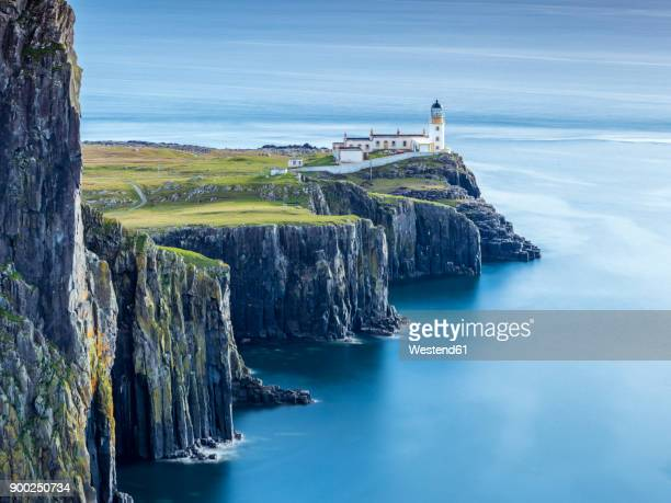 great britain, scotland, isle of skye, lighthouse at neist point - coastline stock photos and pictures