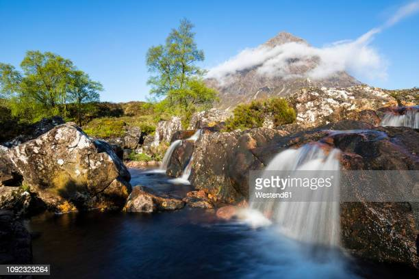 great britain, scotland, scottish highlands, glen etive, mountain massif buachaille etive mor with mountain stob dearg, river coupall, etive mor waterfall - glen etive mor stock pictures, royalty-free photos & images