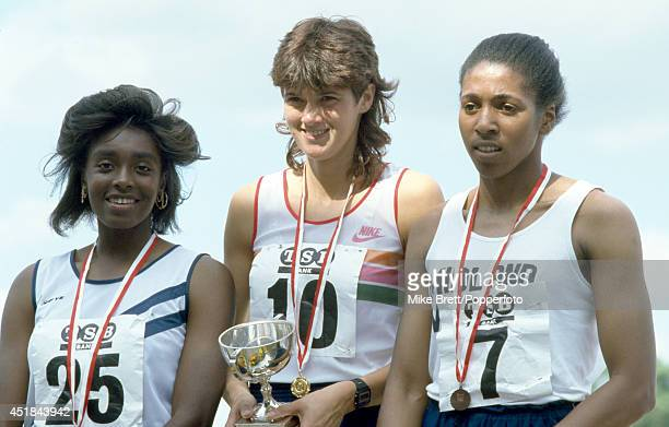 Great Britain sprinter Kathy SmallwoodCook holding the trophy after winning the 200 metres with Georgina Oladapo and Patricia Beckford at the Women's...