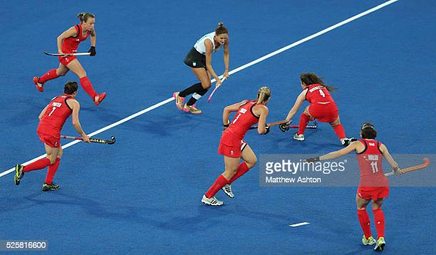 Great Britain surround Luciana Aymar of Argentina during the 2012 London Olympic Summer Games at the Riverbank Arena, Olympic Park, London, UK on...