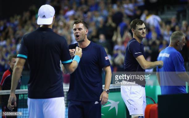 Great Britain team captain Leon Smith congratulates Dominic Inglot of Great Britain after he and his doubles partner Jamie Murray's victory in four...