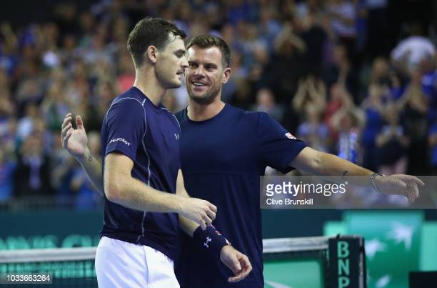Great Britain team captain Leon Smith congratulates Jamie Murray of Great Britain after he and his doubles partner Dominic Inglot's victory in four...