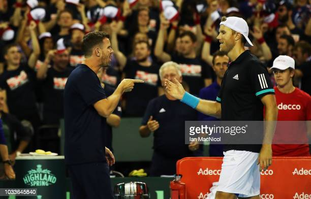 Great Britain team captain Leon Smith is seen after Jamie Murray and Dominic Inglot of Great Britain claim victory during the doubles match between...