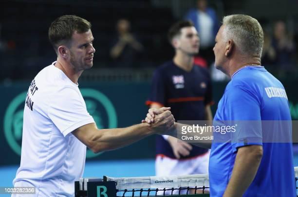 Great Britain team captain Leon Smith shakes hands with Petr Lebed captain of Team Uzbekistan afterJurabek Karimov of Uzbekistans five set victory...