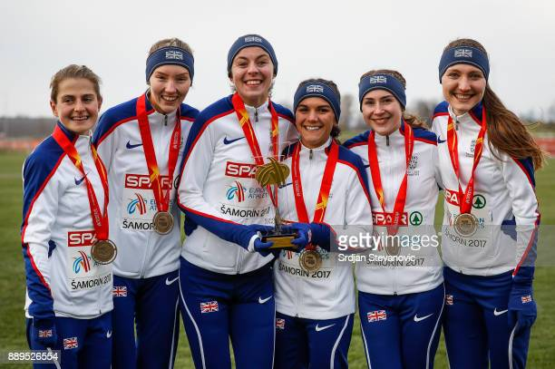 Great Britain team celebrate their Gold Medal during the U23 Women's award ceremony during the SPAR European Cross Country Championships on December...