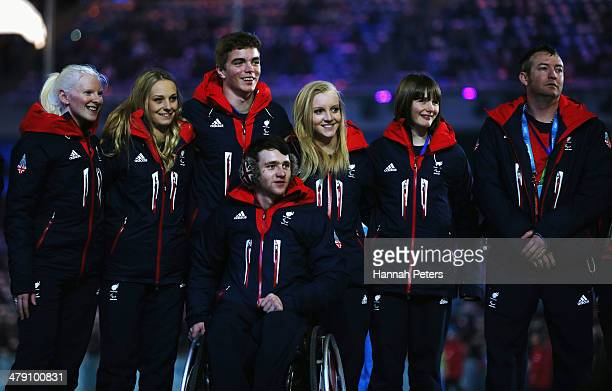 Great Britain team members pose as they enter the stadium prior to the Sochi 2014 Paralympic Winter Games Closing Ceremony at Fisht Olympic Stadium...