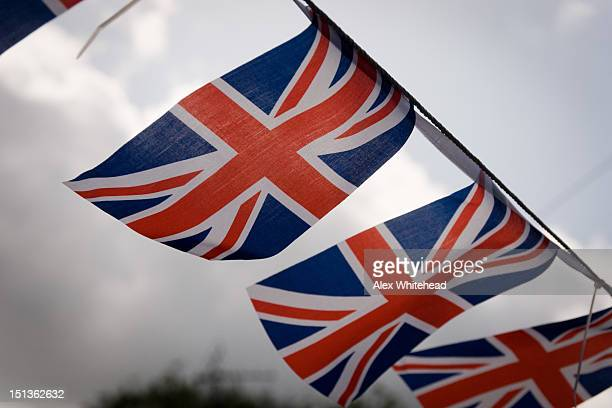 Great Britain Union flags waving under sky