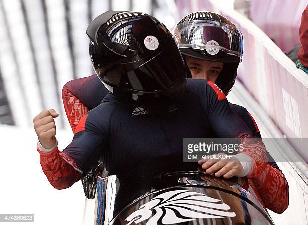 Great Britain1 fourman bobsleigh pilot John James Jackson pushman Stuart Benson pushman Bruce Tasker and brakeman Joel Fearon react after competing...