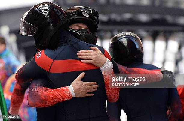 Great Britain1 fourman bobsleigh pilot John James Jackson pushman Stuart Benson pushman Bruce Tasker and brakeman Joel Fearon hug each other after...