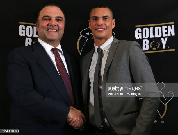 Great Britain's 2012 Olympic Bronze Medalist Anthony Ogogo shakes hands with CEO of Golden Boy Promotions Richard Schaefer during a press conference...