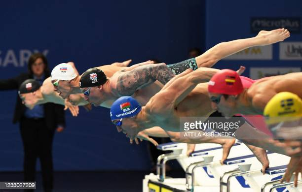 Great Britain's Adam Peaty dives with Belarus' Ilya Shymanovich to compete in a semi-final of the Mens 50m Breaststroke Swimming event during the LEN...