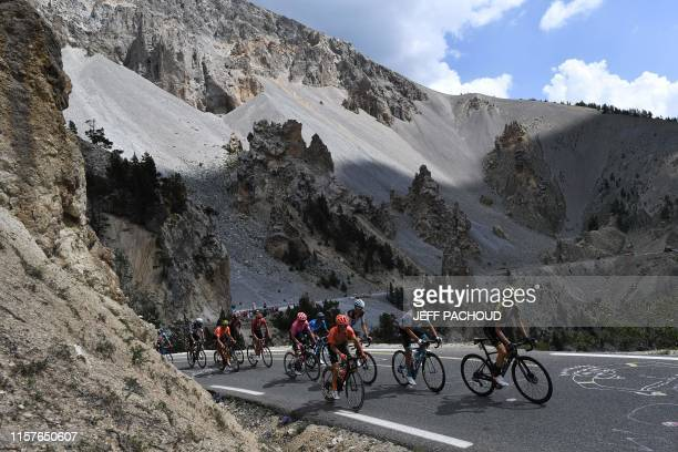 Great Britain's Adam Yates , Kazakhstan's Alexey Lutsenko , France's Romain Bardet and cyclists ride through the Casse Deserte, to the Col due...