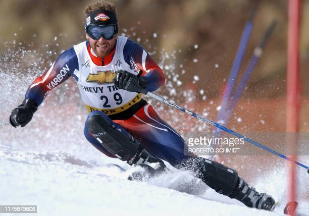 Great Britain's Alain Baxter hits a gate during the men's Alpine World Cup Slalom 24 November 2002 in Park City Utah Baxter did not finish the run...