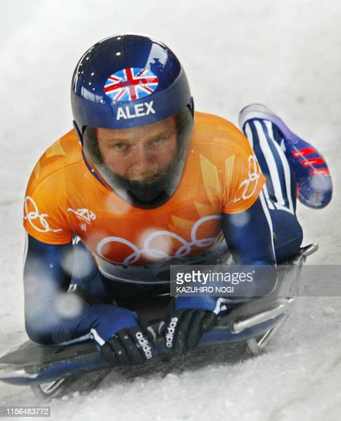 Great Britain's Alex Coomber slows down the ice channel during the first heat for the women's skeleton event for the Salt Lake 2002 Olympic Winter...