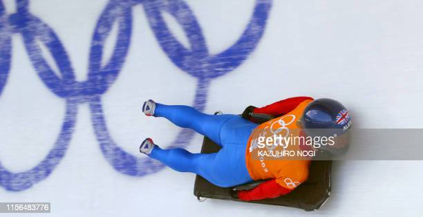 Great Britain's Alex Coomber speeds through the ice channel during a women's skeleton training during the Salt Lake 2002 Olympic Winter Games at the...