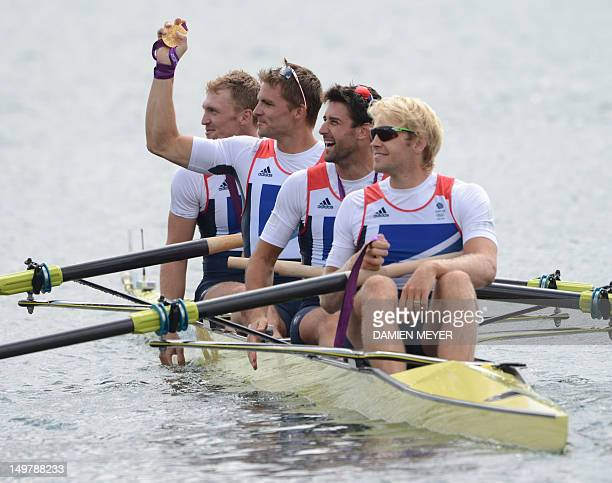 Great Britain's Alex Gregory Pete Reed Tom James and Andrew Triggs Hodge pose on their boat after receiving their gold medal for the men's four final...