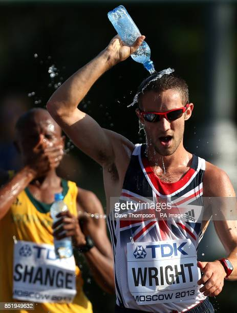 Great Britain's Alex Wright pours water over himself to cool down as he competes in the men's 20 kilometres race walk during day two of the 2013 IAAF...