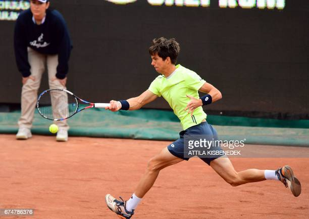 Great Britain's Aljaz Bedene returns the ball to Serbia's Laslo Djere during their semifinal tennis match at the Hungarian Open in Budapest on April...