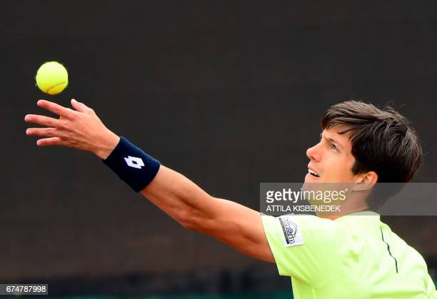 Great Britain's Aljaz Bedene serves the ball to Serbia's Laslo Djere during their semifinal tennis match at the Hungarian Open in Budapest on April...