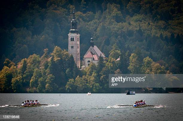 Great Britain's and Nederland's men's eight teams compete in the final race during day five of the FISA Rowing World Championships at Lake Bled on...