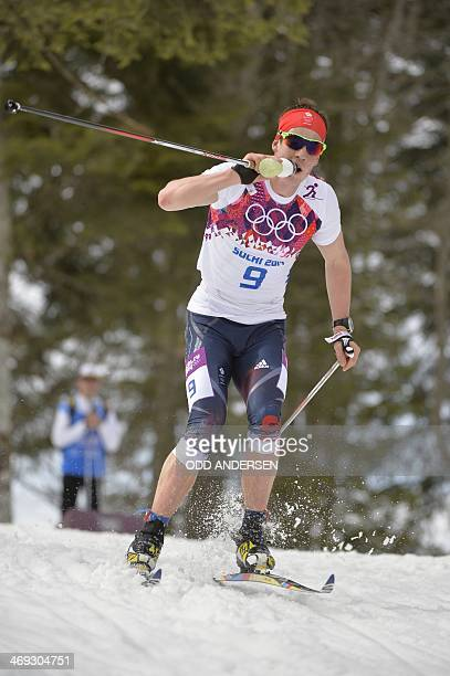 Great Britain's Andrew Musgrave drinks as he competes in the Men's CrossCountry Skiing 15km Classic at the Laura CrossCountry Ski and Biathlon Center...