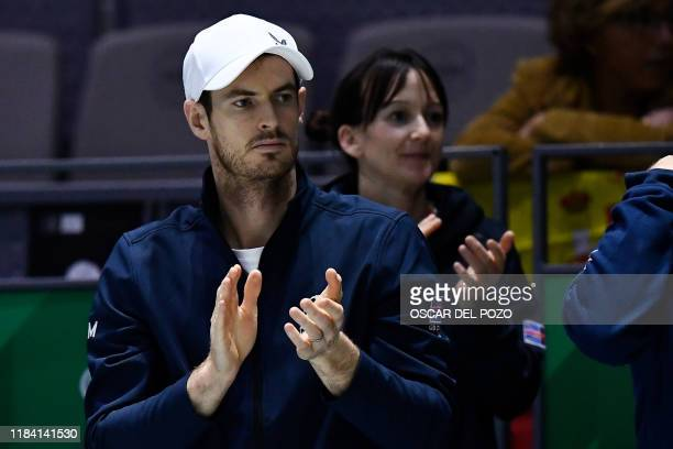 Great Britain's Andy Murray applauds as he attends the semifinal singles tennis match between Great Britain and Spain at the Davis Cup Madrid Finals...
