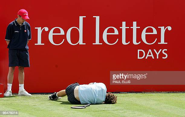 Great Britain's Andy Murray lies injured during his first round match against Russia's Dmitry Tursunov at the Nottingham Open Nottingham June 20 2006...