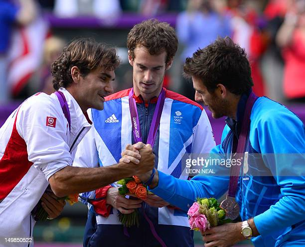 Great Britain's Andy Murray , Switzerland's Roger Federer and Argentina's Juan Martin del Potro stand on the podium with their gold, silver and...