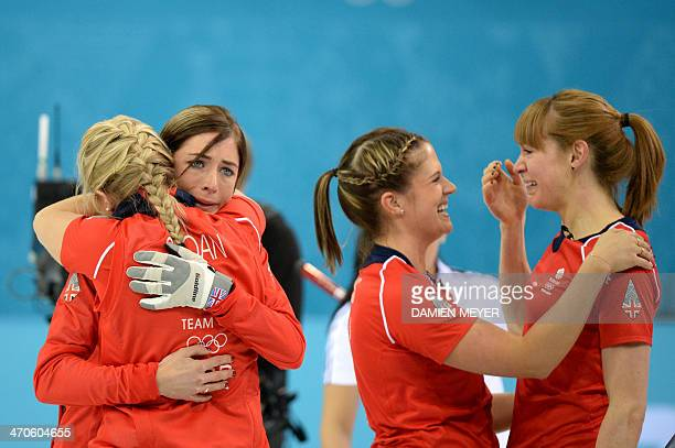 Great Britain's Anna Sloan Eve Muirhead Vicki Adams and Claire Hamilton celebrate after winning the Women's Curling Bronze Medal Game at the Ice Cube...