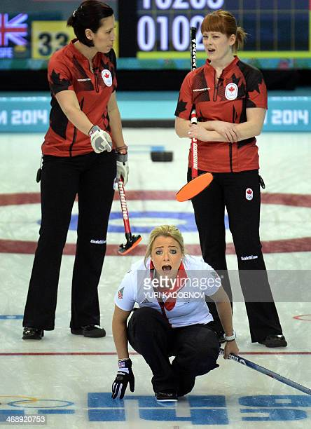 Great Britain's Anna Sloan reacts as she throws the stone during the 2014 Sochi winter Olympics women's curling round robin session 4 match against...