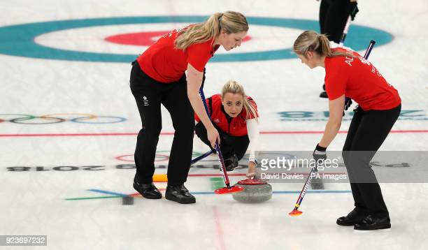 Great Britain's Anna Sloan watches as Lauren Gray and Vicki Adams sweep during the Women's Bronze Medal match at the Gangneung Curling Centre during...