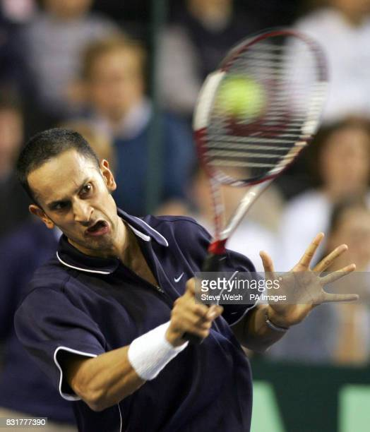 Great Britain's Arvind Parmar in action against Serbia Montenegro's Novak Djokovic during the Davis Cup match at the Braehead Arena Glasgow Friday...