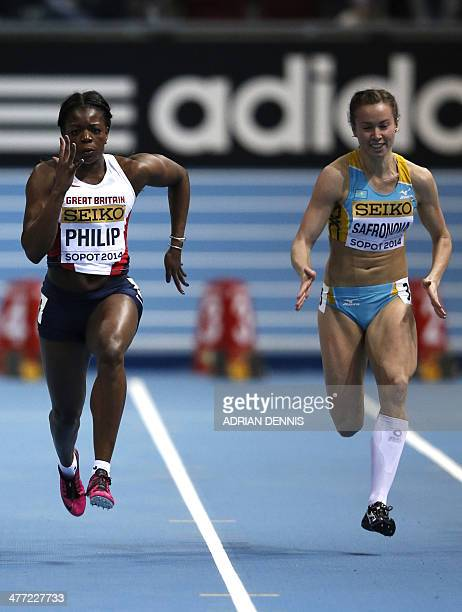 Great Britain's Asha Philip and Kazakhstan's Olga BludovaSafronova compete in women 60 metres heat 1 at the IAAF World Indoor Athletics Championships...