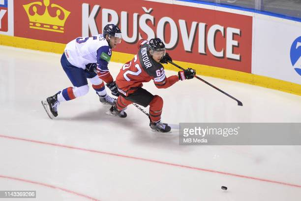 Great Britain's Ben Davies and Canada's Brandon Montour circle for the puck during the 2019 IIHF Ice Hockey World Championship Slovakia group A game...