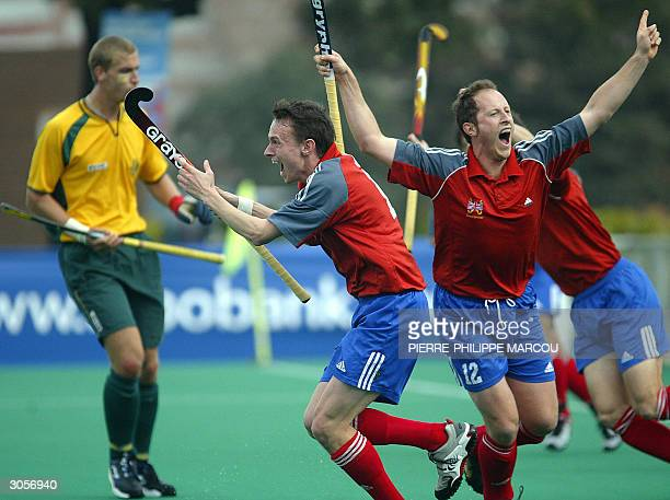 Great Britain's Ben Hawes celebrates with teammates his goal against Republic of South Africa during their Men's Qualifying Tournament match for the...