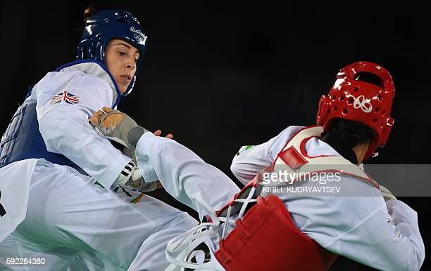 Great Britain's Bianca Walkden competes against Papua New Guinea's Samantha Kassman during their womens taekwondo qualifying bout in the 67kg...