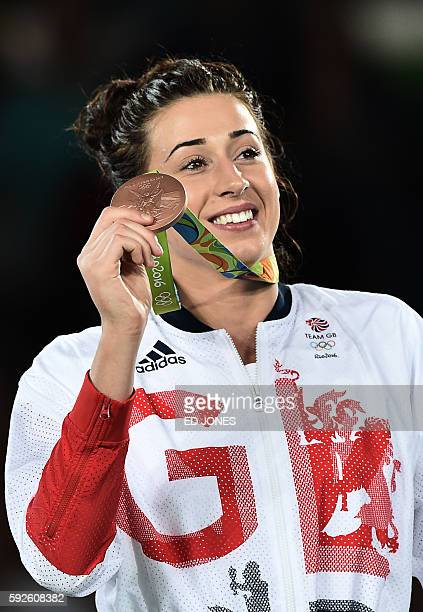 Great Britain's Bianca Walkden poses with her bronze medal on the podium after the womens taekwondo event in the 67kg category as part of the Rio...