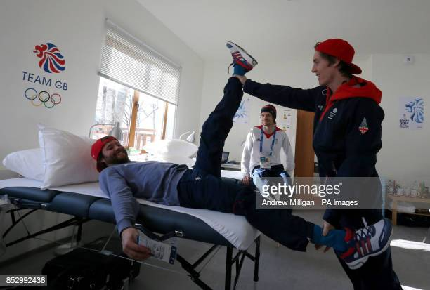 Great Britain's Billy Morgan has his leg stretched by Ben Kilner watched by Dom Harrington in the Athletes Village