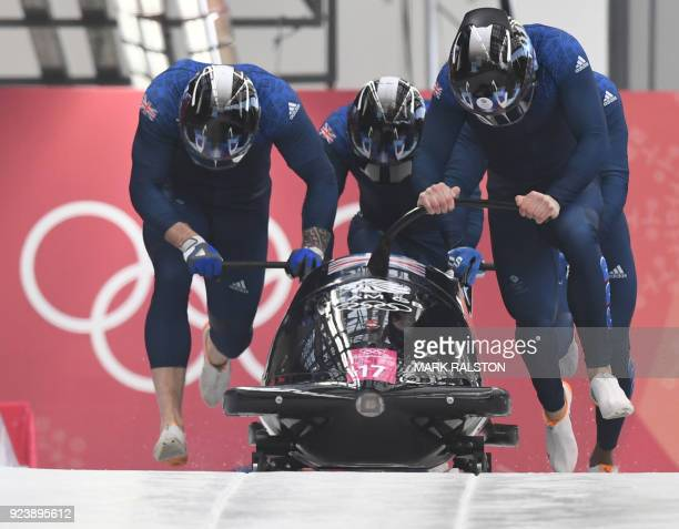 Great Britain's Brad Hall leads his team in the 4man bobsleigh heat 3 run during the Pyeongchang 2018 Winter Olympic Games at the Olympic Sliding...