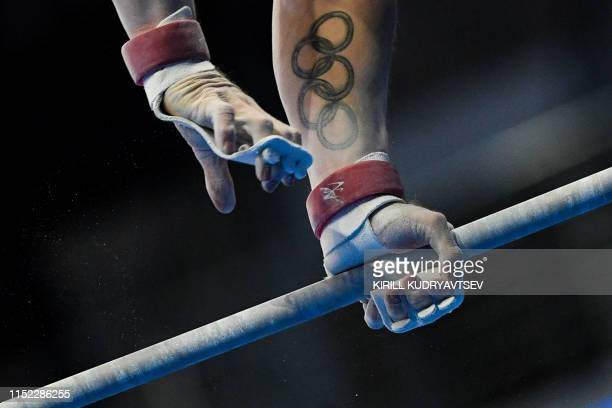 Great Britain's Brinn Bevan competes in the horizontal bar event of the men's allaround qualification of the Artistic Gymnastics at the 2019 European...