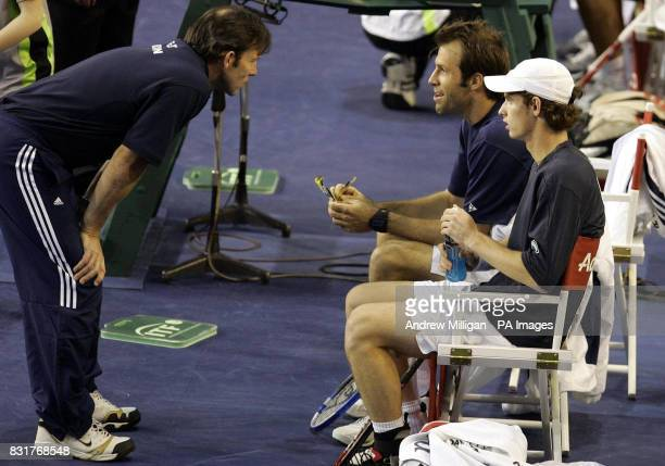 Great Britain's captain Jeremy Bates speaks with Greg Rusedski and Andrew Murray during a break in their doubles match against Serbia and Montenegro...