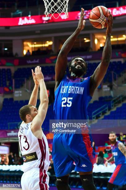Great Britain's center Gabe Olaseni vies for the ball Latvia's guard Janis Strlnieks during FIBA Eurobasket 2017 men's group D basketball match...