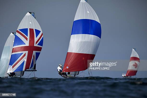 TOPSHOT Great Britain's Charlotte Dobson and Great Britain's Sophie Ainsworth compete next to France's Sarah Steyaert and France's Aude Compan during...