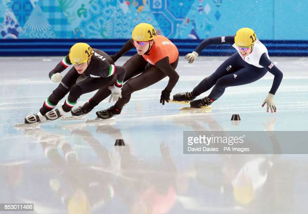 Great Britain's Charlotte Gilmartin lies in third position in the heat of the Womens 500m Short Track skating during the 2014 Sochi Olympic Games in...