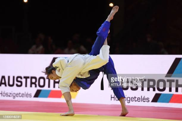 Great Britain's Chelsie Giles fights against Switzerland's Fabienne Kocher in the women's -52kg category during the second day of the 2021 Judo World...