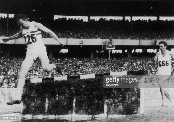 Great Britain's Chris Brasher clears the water jump in the last lap of the 3,000 metre steeplechase at the 1956 Olympic Games in Melbourne, 29th...