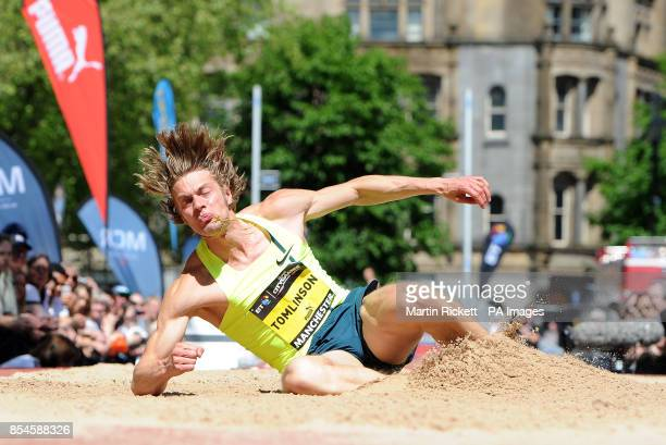 Great Britain's Chris Tomlinson competes in the Long Jump in Albert Square during the BT Great CityGames in Manchester City Centre
