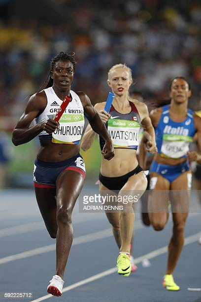Great Britain's Christine Ohurougu and Canada's Sage Watson compete in the Women's 4x400m Relay Round 1 during the athletics event at the Rio 2016...