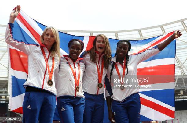 Great Britain's Christine Ohuruogu Kelly Sotherton Marilyn Okoro and Nicola Sanders celebrate after receiving their 2008 Beijing Olympics 4x400m...