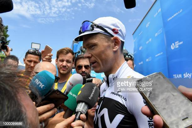 Great Britain's Christopher Froome addresses the media outside his team's hotel in Chambery following a training session with his Great Britain's...